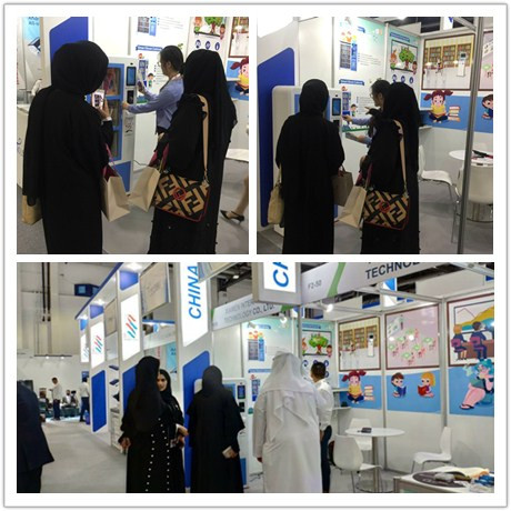 Intech staffs introduce the smart book cabinet to visitors.